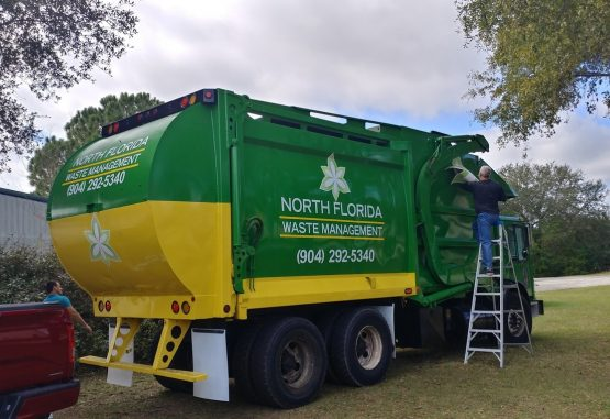 image of a commercial dumpster truck in Jacksonville